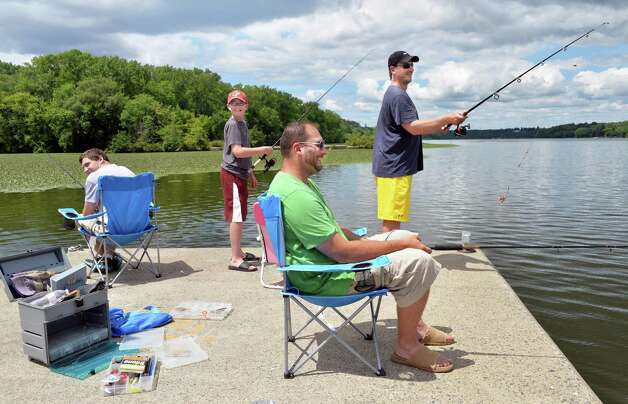 A family fishing party at Lock 7 on the Mohawk River, from left, Ethan Welch of Albany, Tyler Slaney, 12, of Portland, Maine, John Slaney of Portland and Joe Welch of Albany, Thursday July 24, 2014, in Niskayuna, NY.  (John Carl D'Annibale / Times Union) Photo: John Carl D'Annibale / 00027922A