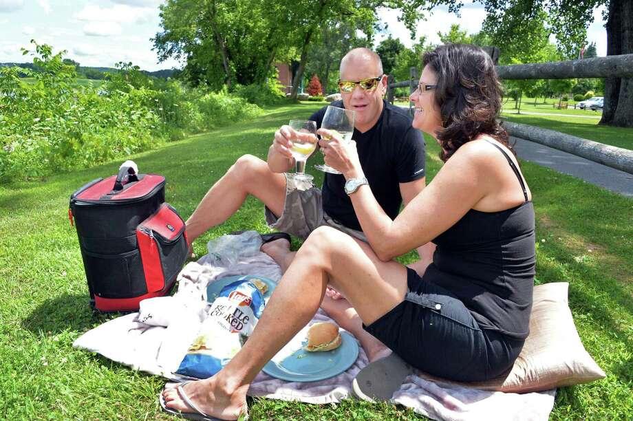 Jeff Stone and wife Marjie Stone of Ballston Lake picnic on the bike path along the Mohawk River Thursday July 24, 2014, in Niskayuna, NY.  (John Carl D'Annibale / Times Union) Photo: John Carl D'Annibale / 00027922A