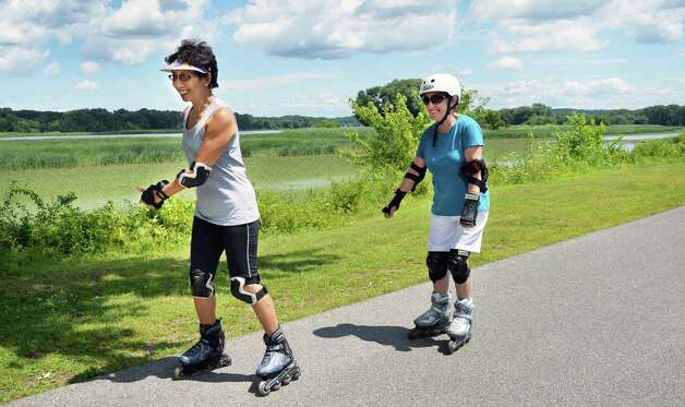 Doris Chow, left, of Scotia and Elaine Bair of Niskayuna rollerblade on the bike path along the Mohawk River Thursday July 24, 2014, in Niskayuna, NY.  (John Carl D'Annibale / Times Union) Photo: John Carl D'Annibale / 00027922A