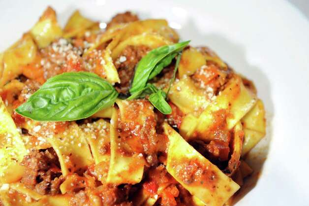 Pappardelle with classic bolognese on Friday, July 18, 2014, at E.K.'s Cibo in Schenectady, N.Y. (Cindy Schultz / Times Union) Photo: Cindy Schultz / 00027833A
