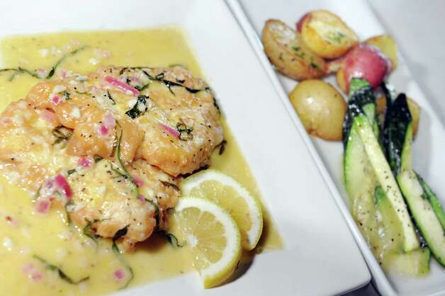 Chicken Francese with roasted baby potatoes and fresh-picked zucchini on Friday, July 18, 2014, at E.K.'s Cibo in Schenectady, N.Y. (Cindy Schultz / Times Union) Photo: Cindy Schultz / 00027833A