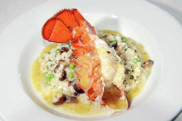 Lobster Risotto with mushrooms and sweet peas on Friday, July 18, 2014, at E.K.'s Cibo in Schenectady, N.Y. (Cindy Schultz / Times Union) Photo: Cindy Schultz / 00027833A