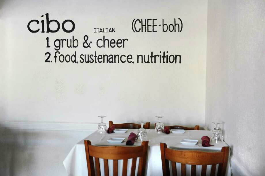E.K.'s Cibo, 1702 Chrisler Ave., Schenectady, 518-952-4210. Visit Web site. Hand-painted message on the lounge wall on Friday, July 18, 2014, at E.K.'s Cibo in Schenectady, N.Y. (Cindy Schultz / Times Union) Photo: Cindy Schultz / 00027833A