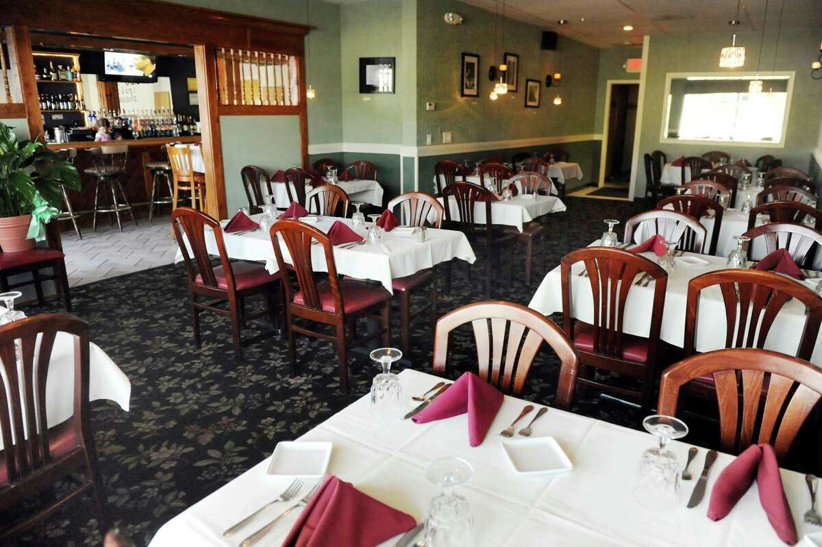 E.K.'s Cibo , 1702 Chrisler Ave., Schenectady, 518-952-4210.Visit Web site.Dining room, and a peek at the lounge, on Friday, July 18, 2014, at E.K.'s Cibo in Schenectady, N.Y. (Cindy Schultz / Times Union)