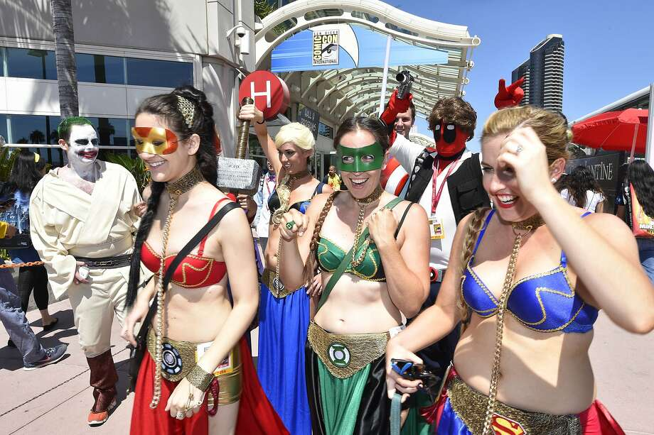 Costumed characters walk outside of the convention center on day 1 of the 2014 Comic-Con International Convention held Thursday, July 24, 2014 in San Diego. Photo: Denis Poroy, Associated Press