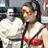Costumed characters walk outside of the convention center on day 1 of the 2014 Comic-Con International Convention held Thursday, July 24, 2014 in San Diego.