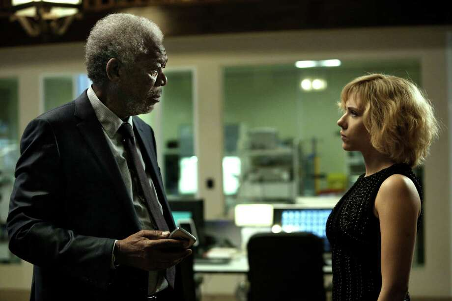 "This image released by Universal Pictures shows Morgan Freeman, left, and Scarlett Johansson in a scene from ""Lucy."" (AP Photo/Universal Pictures, Jessica Forde) ORG XMIT: CAET342 Photo: Jessica Forde / Universal Pictures"