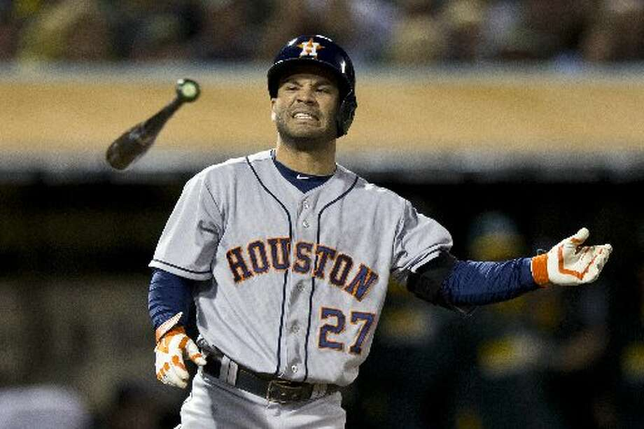 July 23: Athletics 9, Astros 7  Jose Altuve reacts after striking out during the fifth inning. Photo: Jason O. Watson, Getty Images