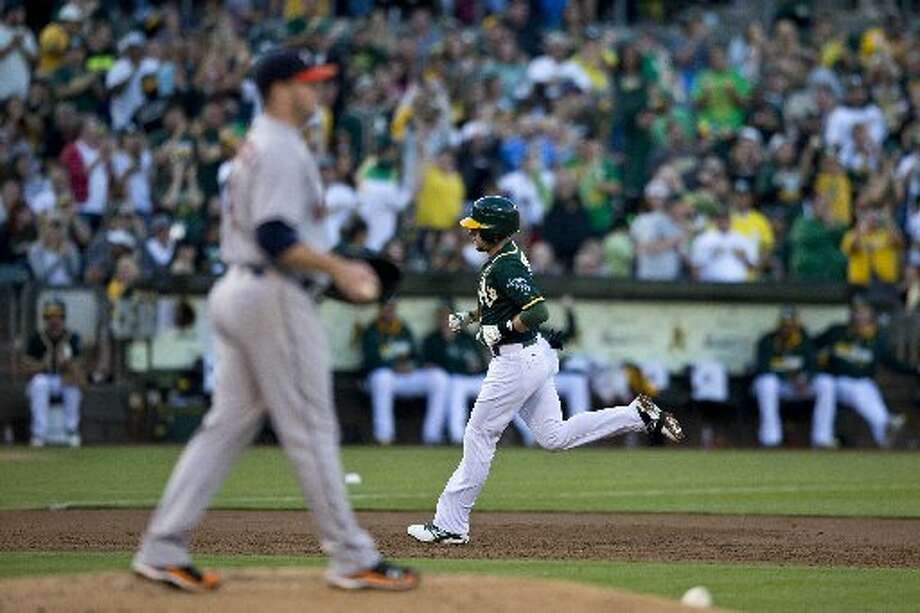 Jed Lowrie rounds the bases after hitting a home run off of Brad Peacock during the second inning. Photo: Jason O. Watson, Getty Images