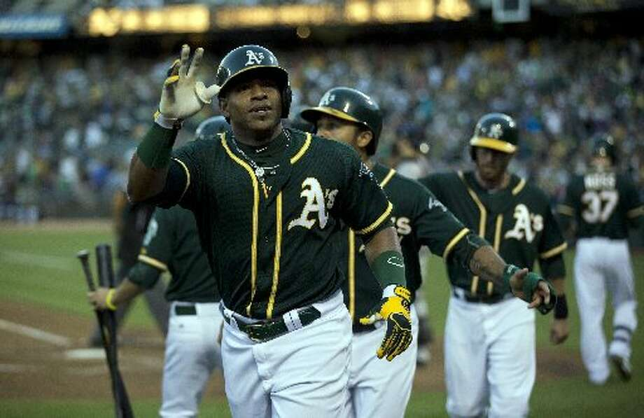The Oakland Athletics' Yoenis Cespedes waves to the crowd after hitting a three-run home run in the second inning Photo: D. Ross Cameron, MCT