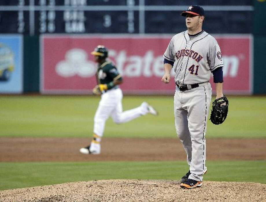 Astros starting pitcher Brad Peacock stands on the mound after giving up a three-run home run to the Yoenis Cespedes, left, during the second inning. Photo: Associated Press