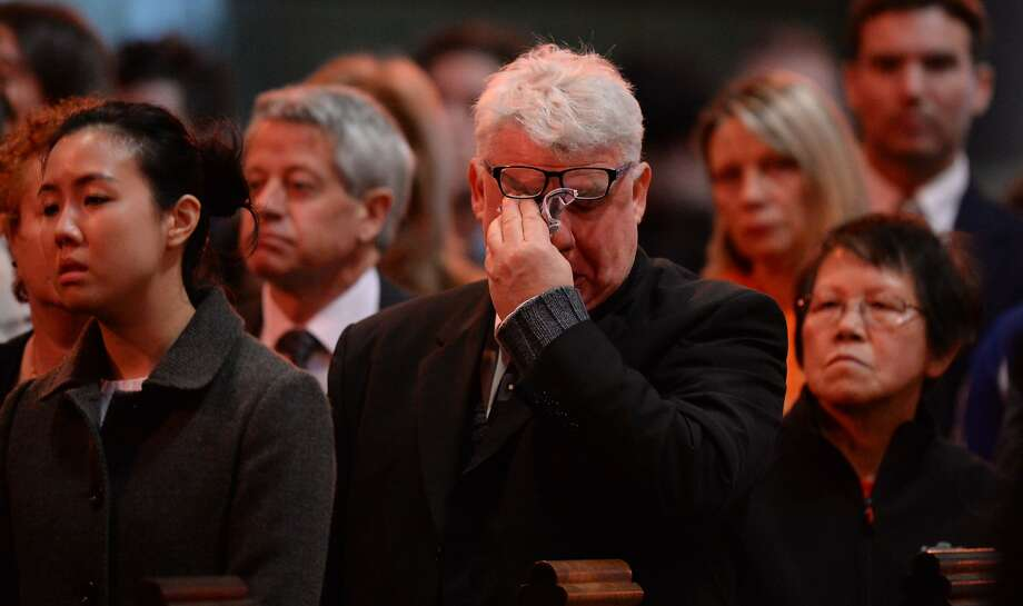Family and friends attend a multi-faith service in Melbourne for the victims of the downed airplane. Photo: Mal Fairclough, AFP/Getty Images