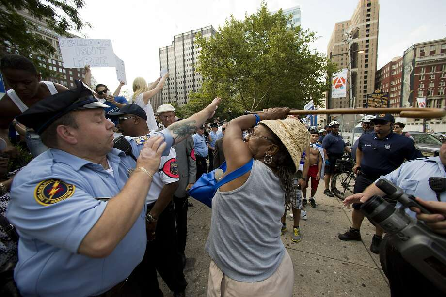 Meanwhile, in the City of Brotherly Love ...Police try to stop a cane-wielding woman from beating   another woman supporting the Israeli offensive in Gaza. Photo: Associated Press