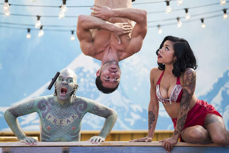 "Lincecum fan:Circus performers ""Lizard Man,"" acrobat Danik Abishev and sword-swallower Heather Holliday pose for