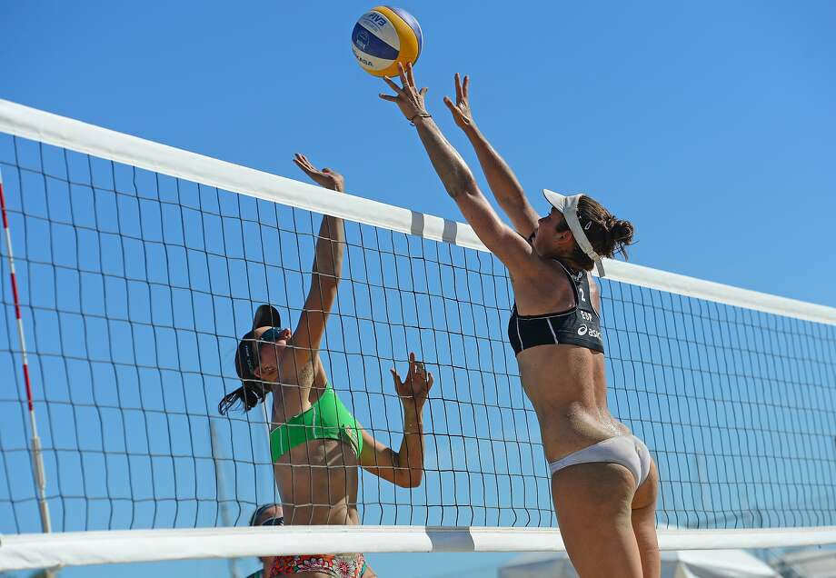 Stuff that shot! Elsa Baquerizo (right) of Spain attempts to block the spike by Ekaterina Syrtseva of Russia during 