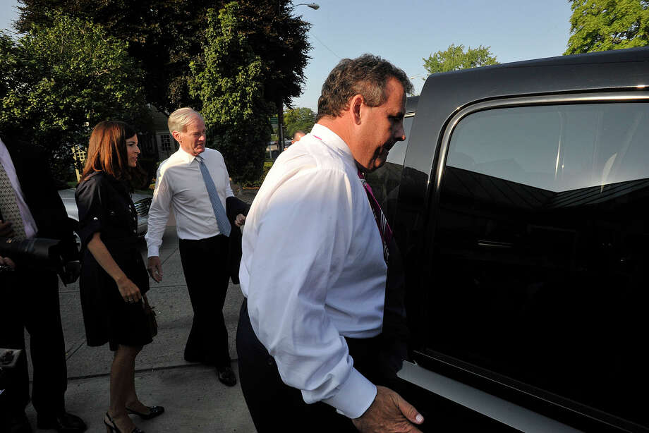 New Jersey Governor Chris Christie enters an SUV after meeting with and stumping for Connecticut Republican gubernatorial candidate Tom Foley, center with wife Leslie Foley, at Glory Days Diner in Greenwich, Conn., before going to a private fundraiser in Belle Haven on Monday, July 21, 2014. Governor Christie is under fire by some for using a New Jersey State Police helicopter to attend a political and fundraising trip to Connecticut earlier this week. The bill for the trip, reckoned to be $10,000 by a person with direct knowledge of Christie's transportation expenses, will be picked up by the Christie-headed Republican Governors Association and the Connecticut GOP. Photo: Jason Rearick / Stamford Advocate