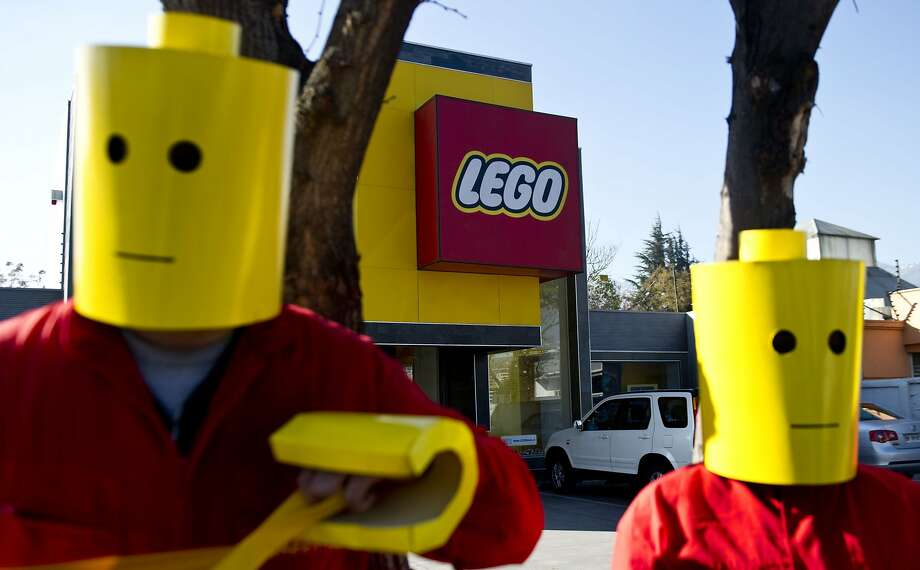 Shell-LEGO alliance decried: Greenpeace activists demonstrate in front of LEGO headquarters in Santiago, Chile. The environmentalists were protesting Shell's oil search in the Arctic and demanding LEGO remove Shell logos from their toys. Photo: Martin Bernetti, AFP/Getty Images