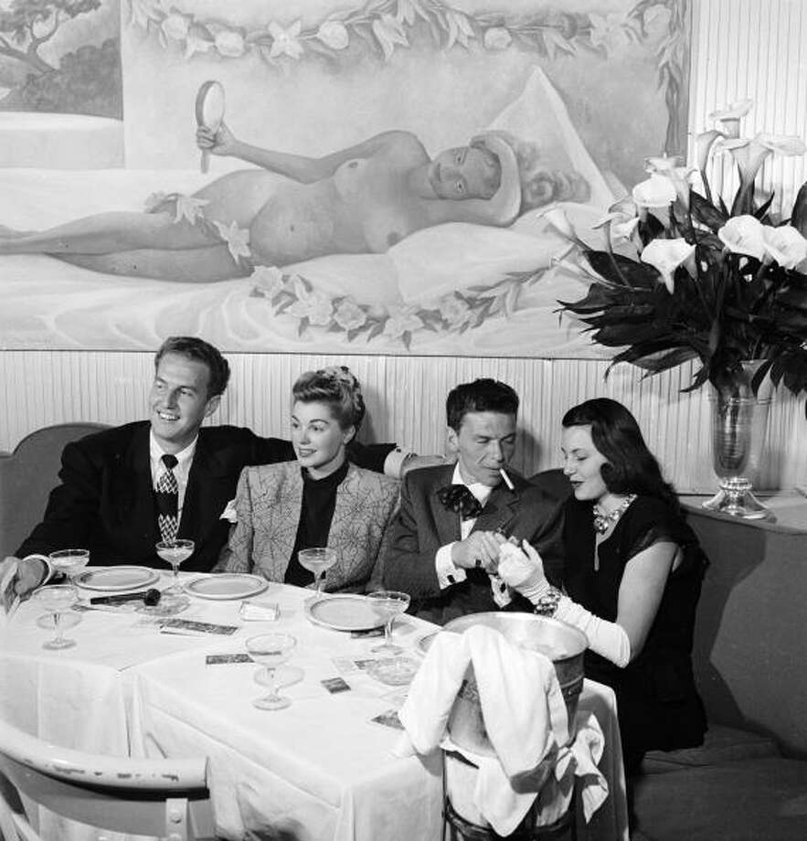 Frank SinatraPhoto: Ben Page, husband of Esther Williams, entertainer Frank Sinatra & actress Cyd Charisse in the Champagne Room at Ciro's. Photo: Peter Stackpole, The LIFE Picture Collection/Gett / Time & Life Pictures