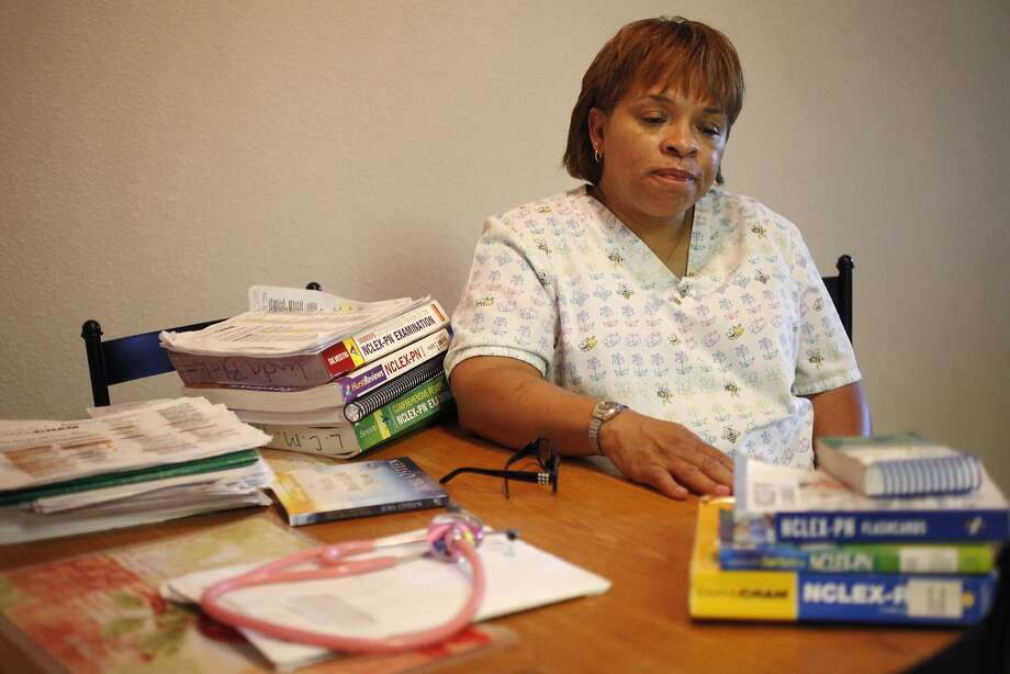 "Linda Blake, 54, a Certified Nursing Assistant and a Home Health Aid, pictured with her study materials June 5, 2014 at her home in Fairfield, Calif. Blake graduated from a Licensed Vocational Nursing program at Intercoast in September 2013. She doesn't feel like the school adequately equipped her for the exam. Since then, she has spent $300 on a Hurst review course and has failed the test once, which costs $350 and can be taken up to eight times. ""I don't want this to happen to anyone else,"" she said of the experience. Photo: Leah Millis, The Chronicle"