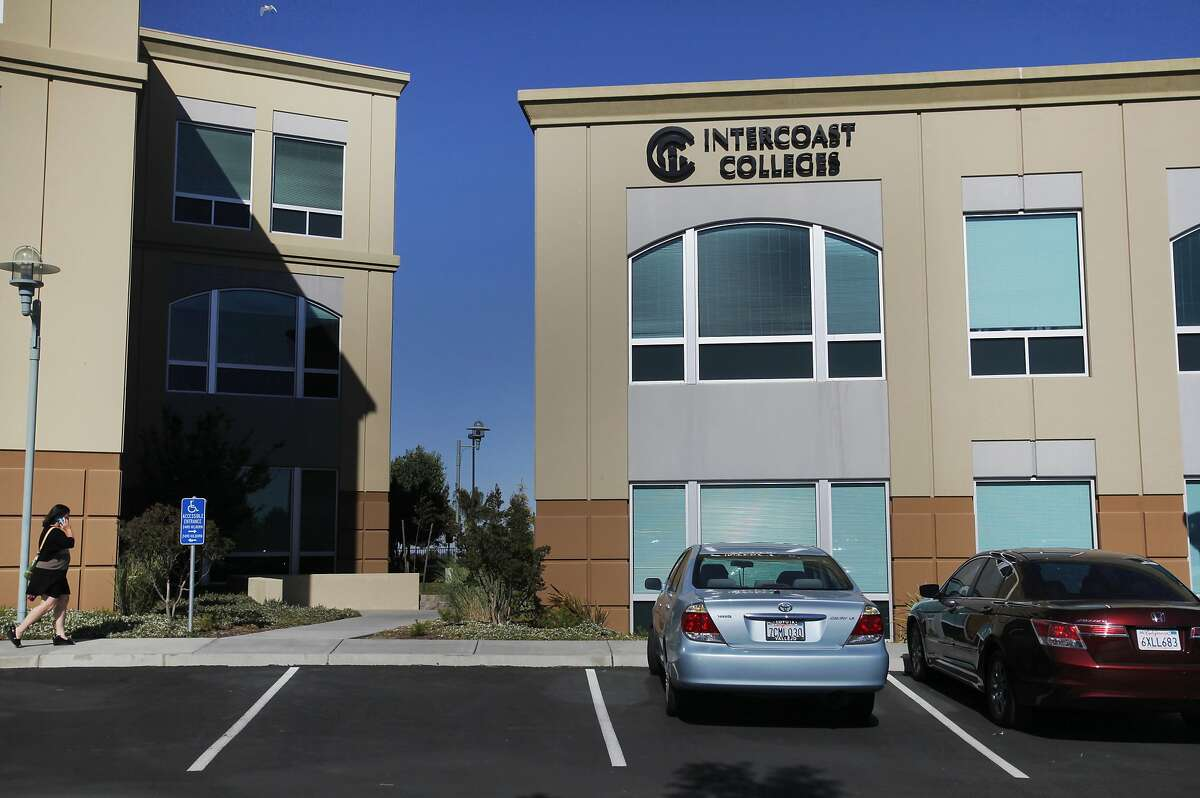 A woman walks near the building in which Intercoast College is located June 17, 2014 in Fairfield, Calif.