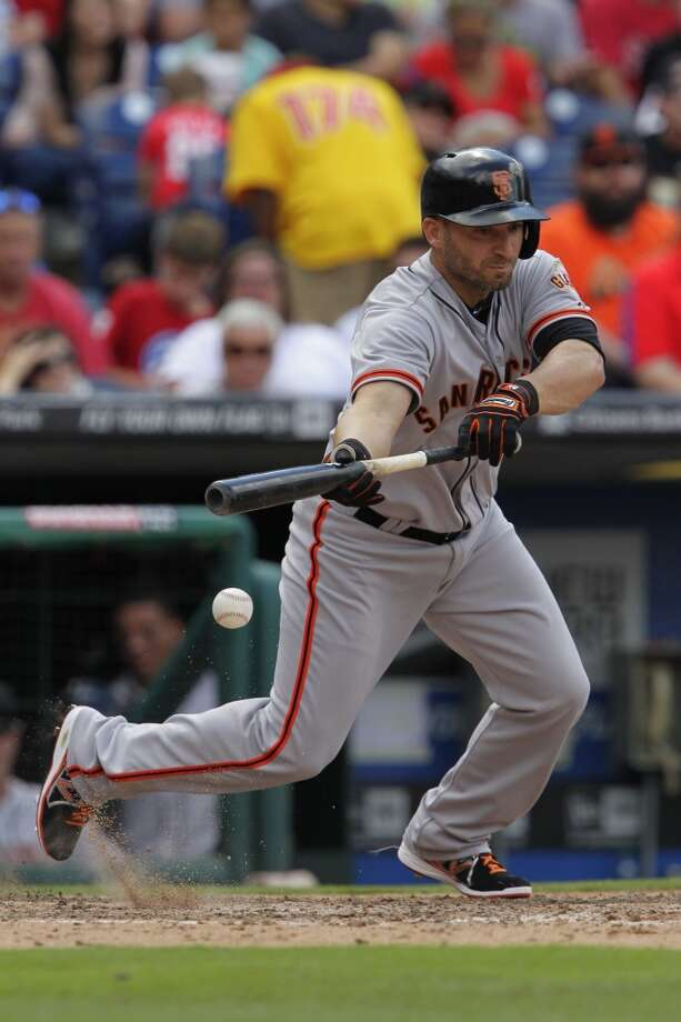 Marco Scutaro (19) of the San Francisco Giants attempts to bunt in the seventh inning during a game against the Philadelphia Phillies at Citizens Bank Park on July 24, 2014 in Philadelphia, Pennsylvania. The Phillies won 2-1. Photo: Hunter Martin, Getty Images