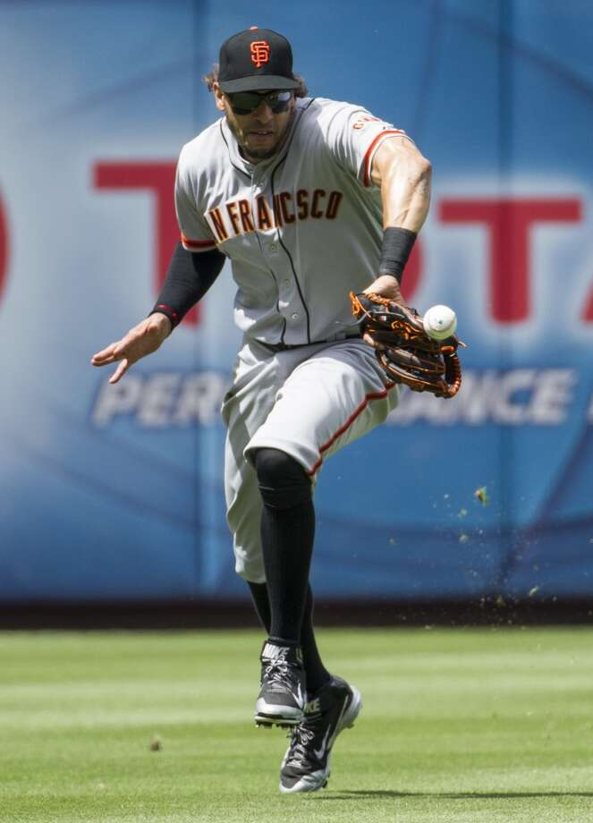 San Francisco Giants left fielder Michael Morse misplays the ball  hit by Philadelphia Phillies' Ben Revere for an error during the fifth inning of a baseball game, Thursday, July 24, 2014, in Philadelphia. The Phillies won 2-1. Photo: Chris Szagola, Associated Press