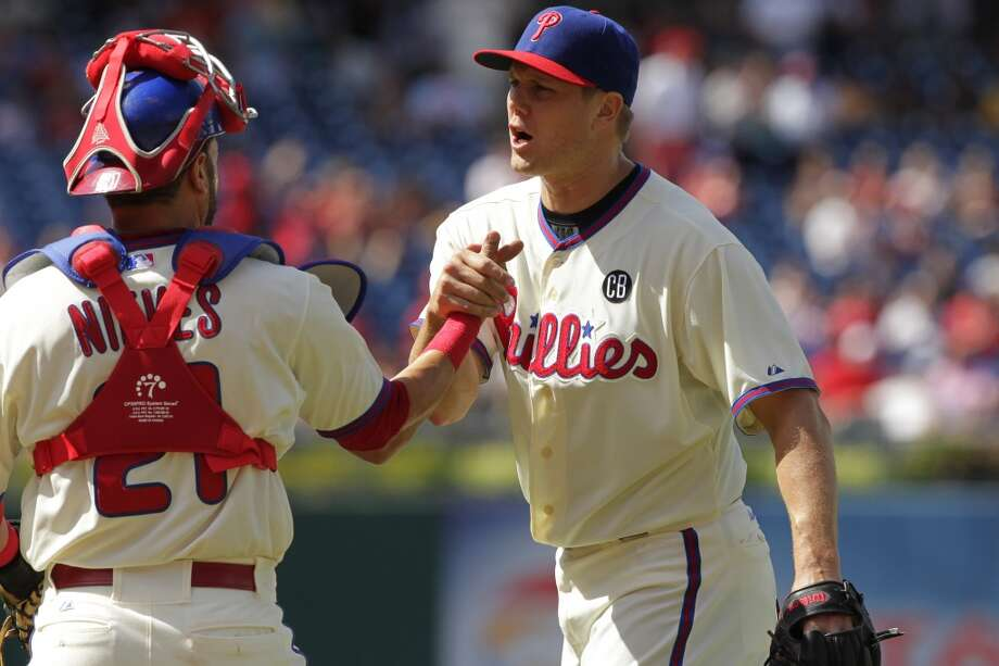Closer Jonathan Papelbon #58 of the Philadelphia Phillies celebrates with catcher Wil Nieves #21 after saving the game against the San Francisco Giants at Citizens Bank Park on July 24, 2014 in Philadelphia, Pennsylvania. The Phillies won 2-1. Photo: Hunter Martin, Getty Images