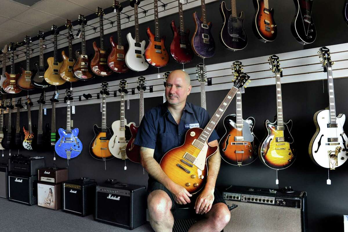 Rick Tedesco, owner of Guitar Hangar at 270 Federal Road in Brookfield, Conn. is photographed in his store, Wednesday, July 23, 2014.