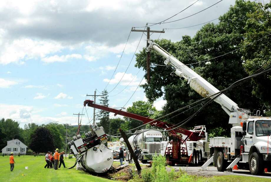 Crews cleanup after a truck rolled over on Bridge Street Thursday July 24, 2014 in Selkirk, N.Y. A witness on the scene said the driver climbed from the crumpled truck cab unscathed following the accident. (Michael P. Farrell/Times Union) Photo: Michael P. Farrell
