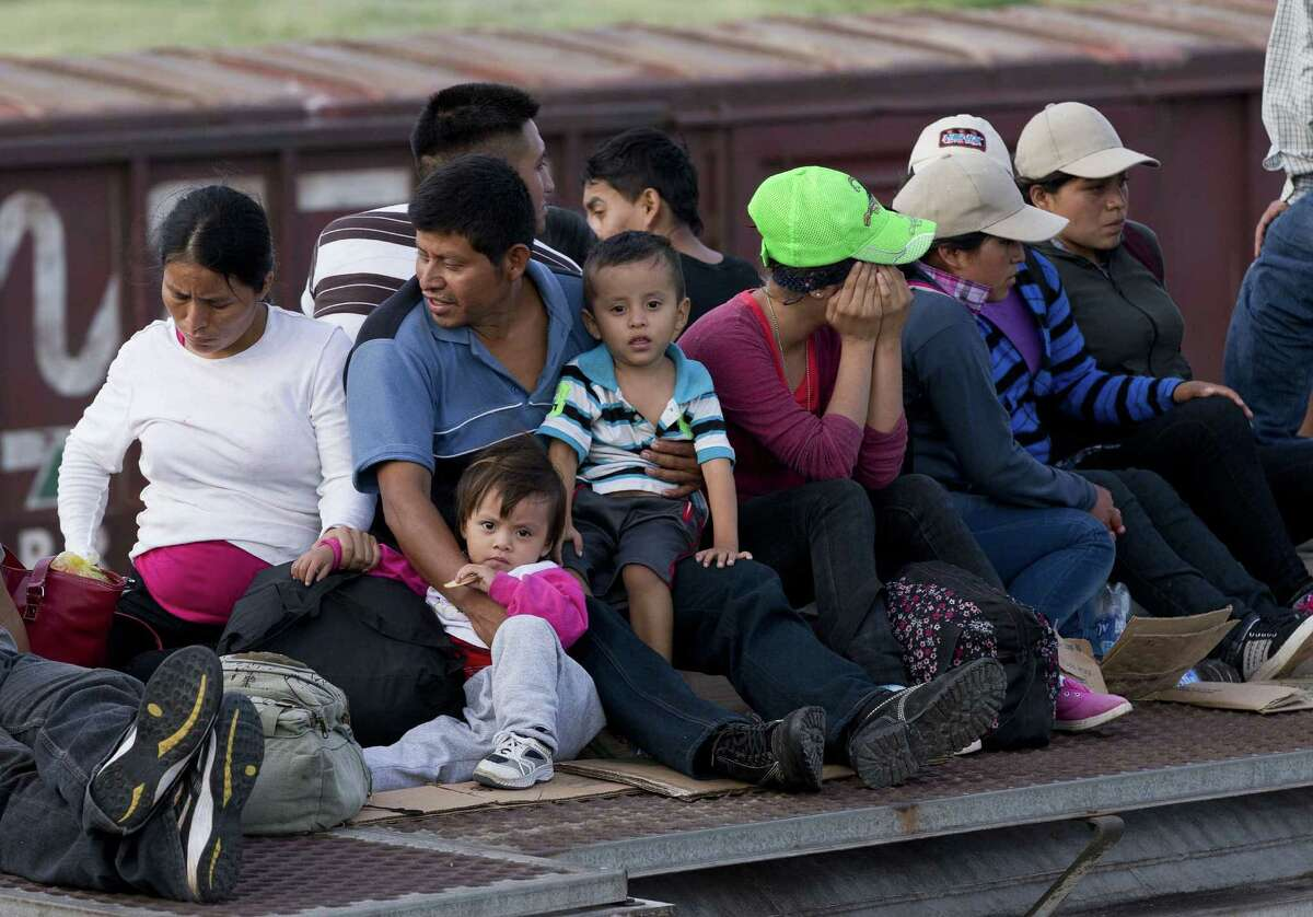 Central American migrants ride a freight train this month. The U.S. has, since 1980, accepted a high of 207,000 refugees in 1980 and a low of 27,000 in 2002. Now, apparently, there is no room in the inn for refugees from Central America.