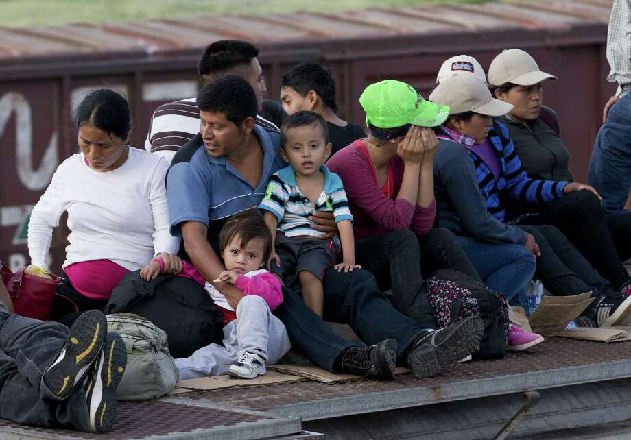 Central American migrants ride a freight train this month. The U.S. has, since 1980, accepted a high of 207,000 refugees in 1980 and a low of 27,000 in 2002. Now, apparently, there is no room in the inn for refugees from Central America. Photo: Eduardo Verdugo / Associated Press / AP