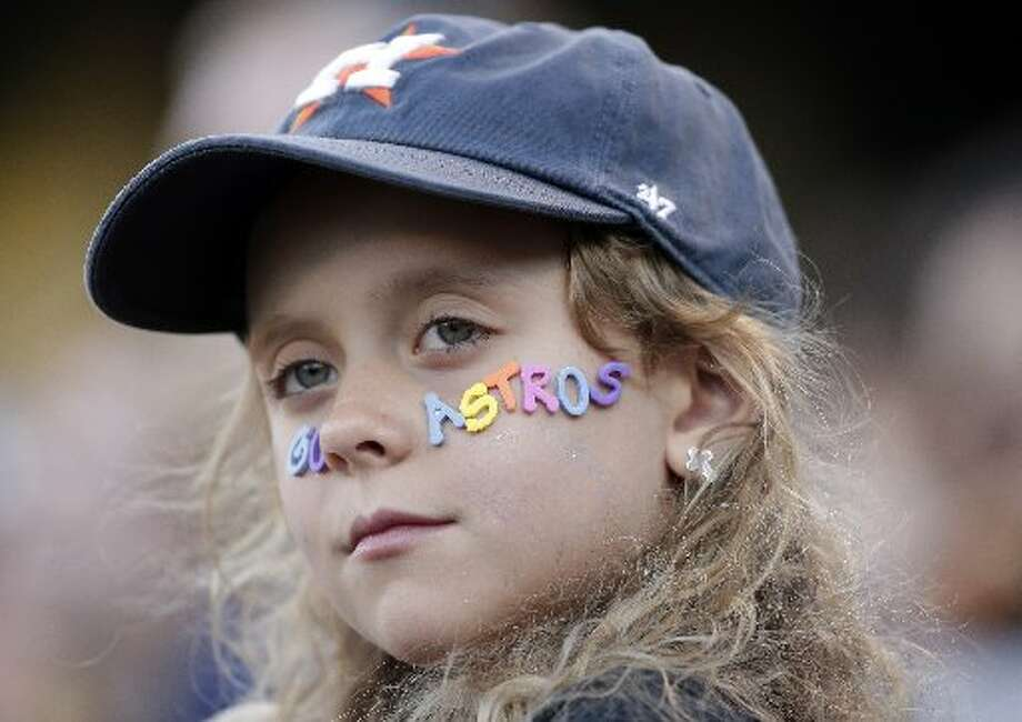 A young fan wears an Astros sign on her cheek Photo: Associated Press