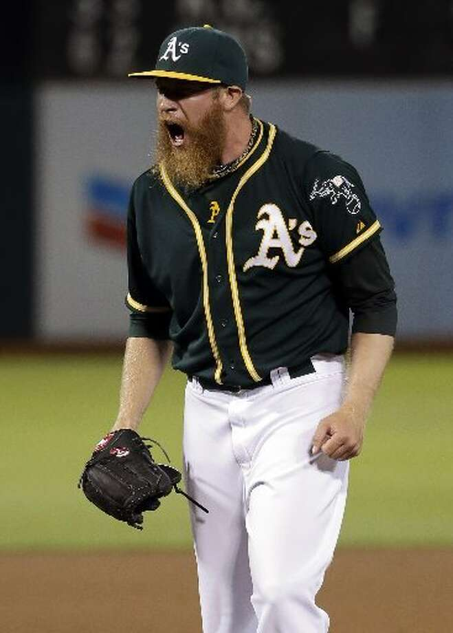 Athletics relief pitcher Sean Doolittle celebrates after recording the last out of the game. Photo: Associated Press