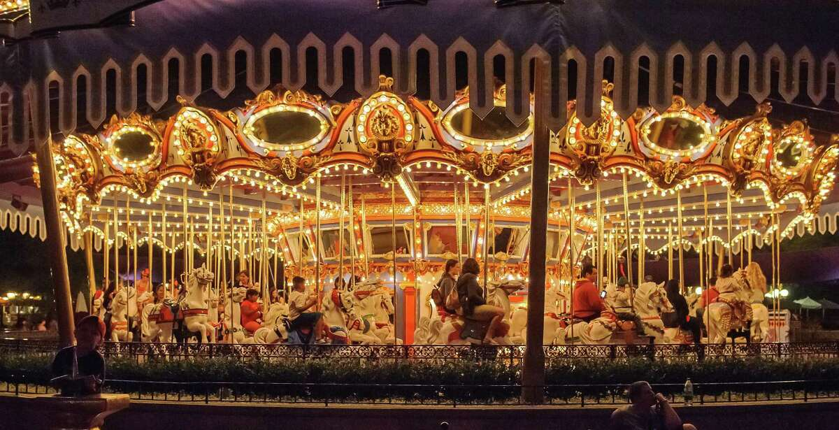 Fantasyland's merry-go-round, known as the King Arthur Carrousel, attracts visitors day and night. It looks even more spectacular after sunset.