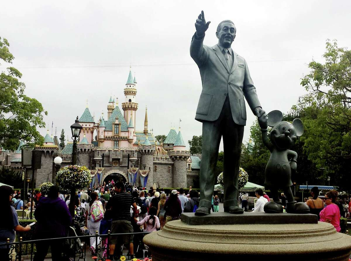 The statue of Walt Disney and Mickey Mouse greets visitors to Disneyland. It's the first thing visitors see once they are past Main Street and headed into the park.
