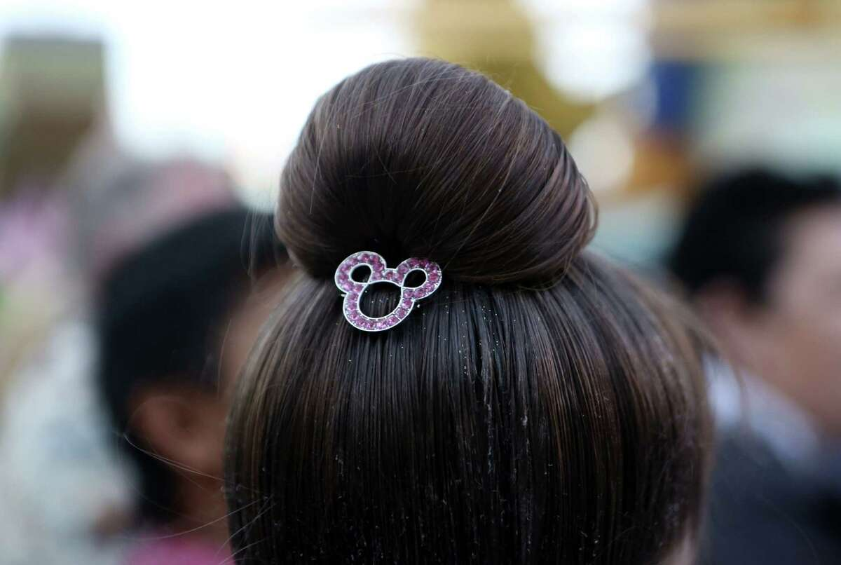 A hairdo from the Bippity Boppity Boutique was a great splurge. It came with a keepsake accessory, such as a rhinestone mouse-shaped barrette, and the hairspray-laden style lasted for three days.