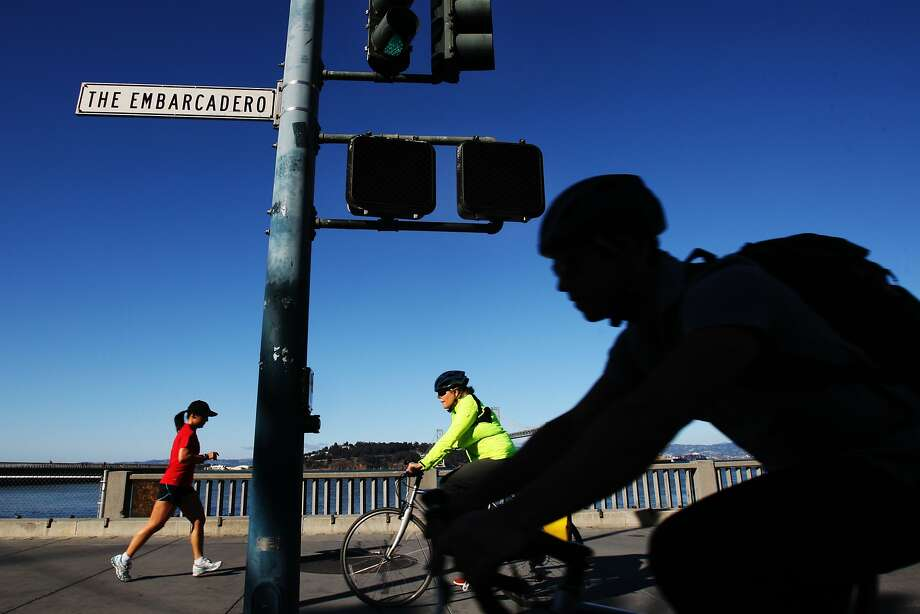 Bicyclists cruise the Embarcadero on a sunny day. Planners are looking at creating separated bikeways. Photo: Craig Hudson, The Chronicle