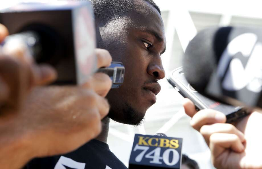 San Francisco 49ers' Aldon Smith, (99) speaks to the media on Thursday July 24, 2014  during training camp as the team prepares for the 2014 season in Santa Clara, Calif. Photo: Michael Macor, The Chronicle