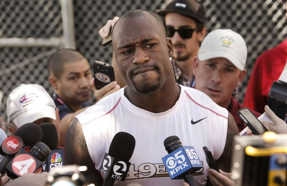 San Francisco 49ers' tight end Vernon Davis,(85) ponders a question from  the media on Thursday July 24, 2014 during training camp as the team prepares for the 2014 season in Santa Clara, Calif. Photo: Michael Macor, The Chronicle