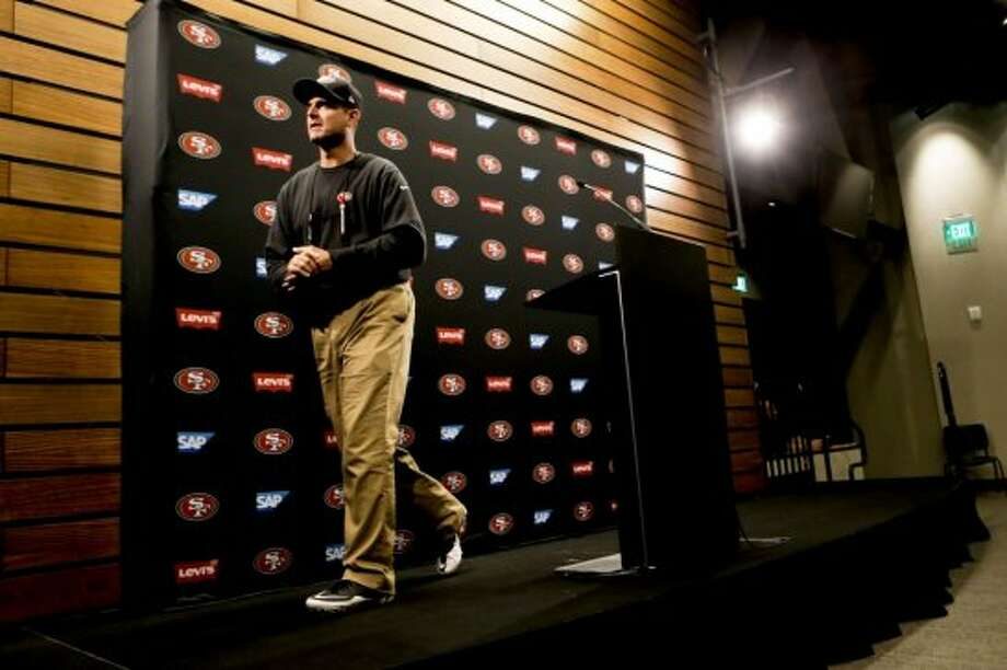 San Francisco 49ers head coach Jim Harbaugh leaves the podium after holding his first press conference in the new Levi's Stadium, on Thursday July 24, 2014 during training camp as the team prepares for the 2014 season in Santa Clara, Calif. Photo: Michael Macor, The Chronicle