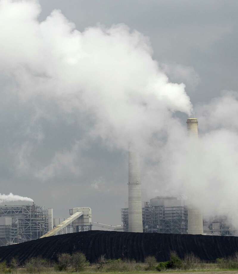 Exhaust rises from   an electricity-generating station in Thompsons, near Sugar Land. Our state generates a lot of emissions but seems deaf to what our scientists caution against. Photo: Associated Press File Photo / AP