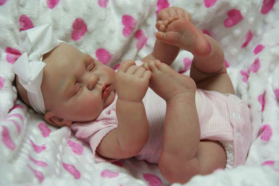 Kristy Walker of Dickinson has been crafting realistic baby dolls for the past seven years, relying on social media word-of-mouth to market her dolls. Prices range from $450 to $1,000, depending on specifications and intricacy. Photo: Kristy Walker