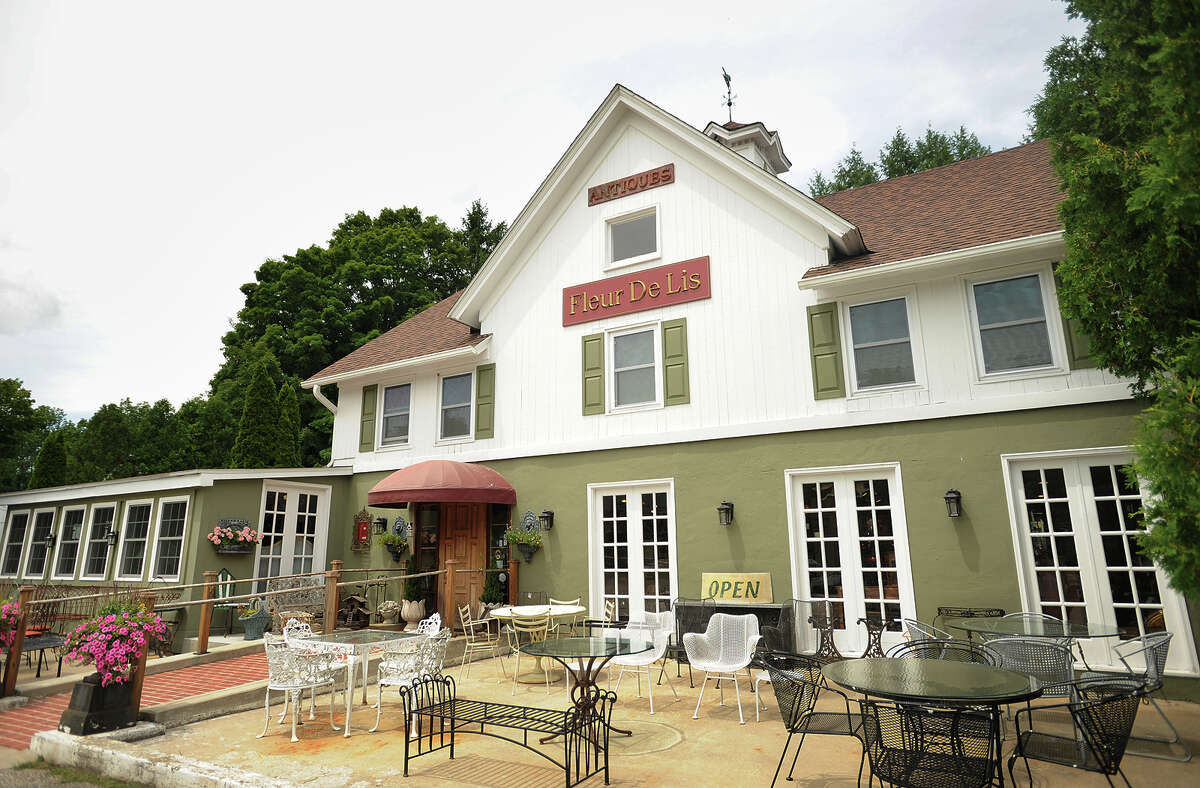 Fleur De Lis Antiques and Design at 4 Long Ridge Road in West Redding, Conn. Owner Dottie DeLuca said her shop has been 'extremely busy' with new customers from New York City who recently relocated to the area.