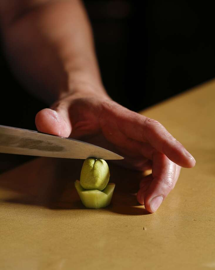 Sho Kamio of Iysasare works on tofu paste on Thursday, July 17, 2014 in Berkeley, Calif. Photo: Russell Yip, The Chronicle