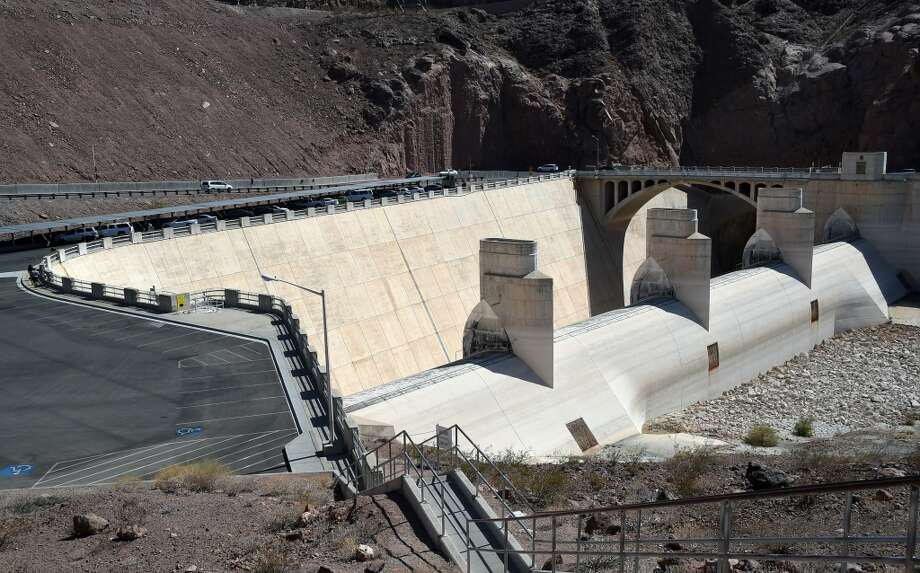 "The Arizona Spillway at the Hoover Dam is shown on July 17, 2014 in the Lake Mead National Recreation Area, Arizona. Last week, North America's largest man-made reservoir dropped below 1,082 feet above sea level, the lowest it's been since the Hoover Dam was built in the 1930s. A 14-year drought in the Southwestern United States and a dwindling supply of water from the Colorado River, in part due to cuts in the reservoir's annual allocation of water from Lake Powell, has left a white ""bathtub ring"" of mineral deposits left by higher water levels on the rocks around the lake as high as 130 feet. The National Park Service has been forced to close or extend boat launch ramps, and move entire marinas to try to keep up with the receding water levels.  (Photo by Ethan Miller/Getty Images) Photo: Ethan Miller, Getty Images"