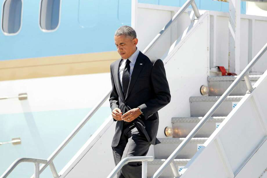 President Barack Obama  walks down the stairs of Air Force One after he arrived at Los Angeles International Airport Wednesday, July 23, 2014, in Los Angeles, for a 24-hour visit.  (AP Photo) Photo: STF / AP