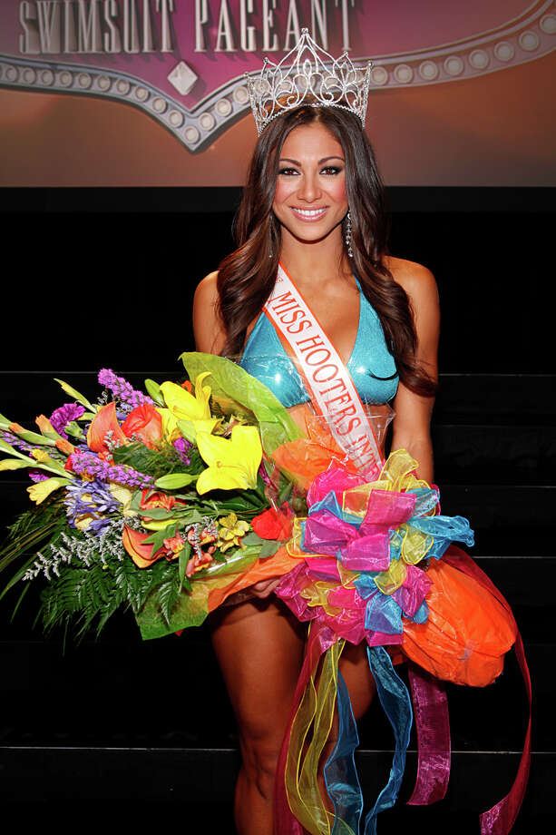 "The annual Hooters International Swimsuit Pageant was held July 23 at the Hard Rock Hotel & Casino in Las Vegas. Over 17,000 girls competed and of those the top 100 were chosen to compete in the pageant. Janet Layug from Lakeland, Florida was crowned as Miss Hooters International 2014. She won a $30,000 cash, features in ""Hooters Magazine"" and the Hooters Calendar as well as a chance to appear in national television commercials and Hooters marketing initiatives."