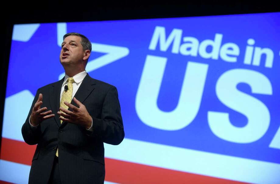 FILE - In this Aug. 22, 2013 file photo, Wal-Mart U.S. President and CEO Bill Simon addresses attendees of the Wal-Mart U.S. Manufacturing Summit in Orlando, Fla. Wal-Mart on Thursday, July 24, 2014 announced it is replacing Simon with Wal-Mart Asia CEO Greg Foran in what could be an indication that the company is losing confidence that its largest business unit will rebound after more than a year of disappointing results. (AP Photo/Phelan M. Ebenhack, File) ORG XMIT: NYBZ102 Photo: Phelan M. Ebenhack / FR121174 AP