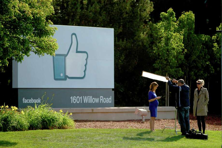 FILE - JULY 23:  According to reports July 23, 2014, Facebook Inc. sales rose to $2.91 billion in the second quarter, compared to $1.8 billion last year, topping the average analyst estimate of $2.81 billion. MENLO PARK, CA - MAY 18: A television crew prepares for a broadcast in front of a 'like' sign outside Facebook headquarters May 18, 2012 in Menlo Park, California. The eight-year-old social network company listed their initial public offering on NASDAQ Friday morning at $38 a share and a valuation of $104 billion, making its IPO the third largest in U.S. history after General Motors and Visa. (Photo by Stephen Lam/Getty Images) ORG XMIT: 144784171 Photo: Stephen Lam / 2012 Getty Images