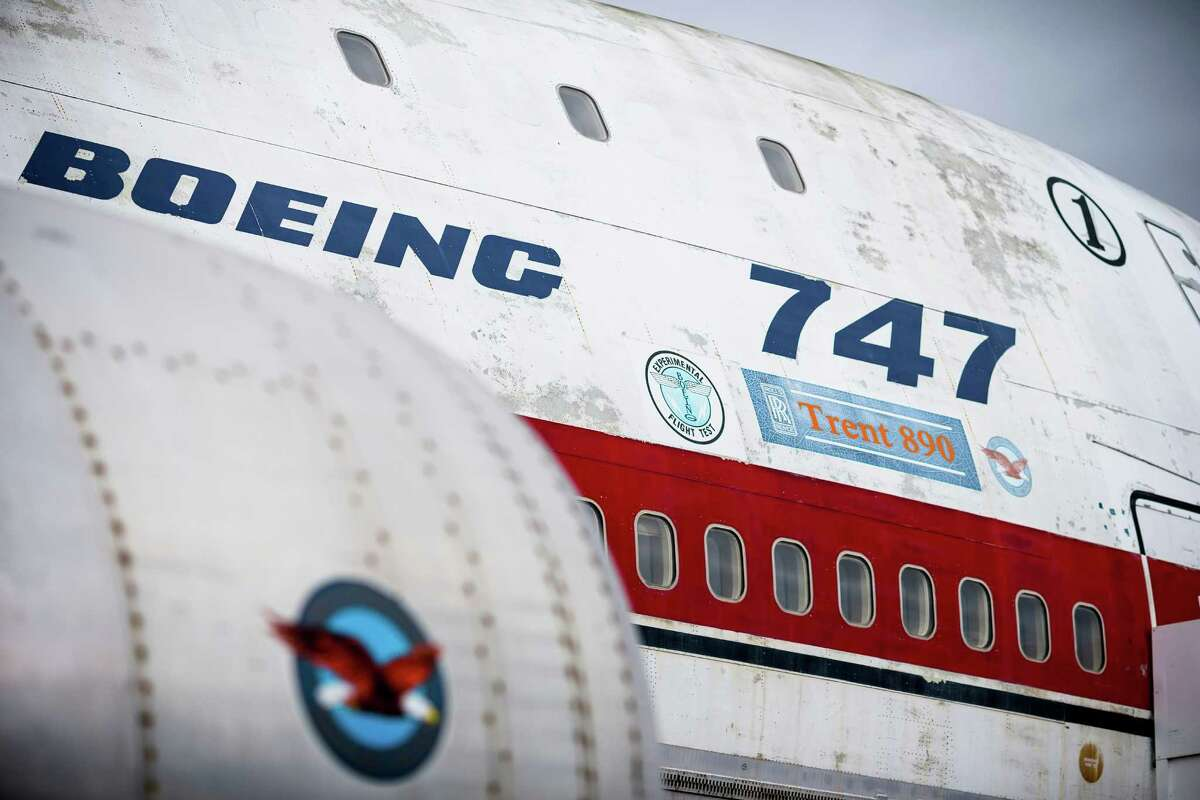 Technicians work to restore the interior and exterior of the original Boeing 747 prototype following decades of outdoor service and display since its maiden flight in 1969, photographed here on Thursday, July 24, 2014, at The Museum of Flight in Seattle, Wash. It was the first 747 ever built, complete with the serial number of 001. The MOF expects the process to be complete by the end of the summer, and the aircraft will remain on exhibit in the Museum Airpark during the process.